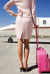 Businesswoman Waiting on Airport Runway --- Image by © Royalty-Free/Corbis